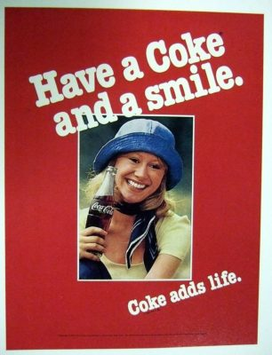 "A vintage ""have a Coke and a smile"" advertisement with a blonde woman"
